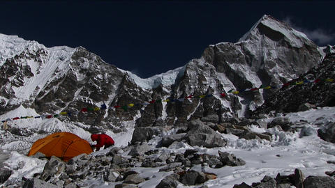 Climber enters tent at basecamp Stock Video Footage
