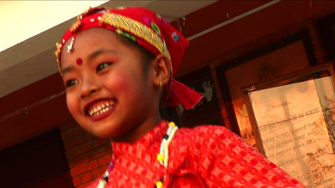 Little girl dancing in traditional outfit at child haven Stock Video Footage