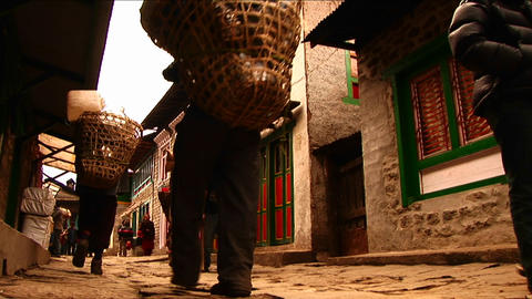 Porters walking through Lukla Stock Video Footage