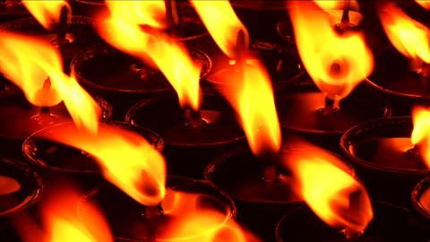 Candles burning inside place of prayer Stock Video Footage