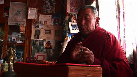 Lama chanting prayer in temple Footage