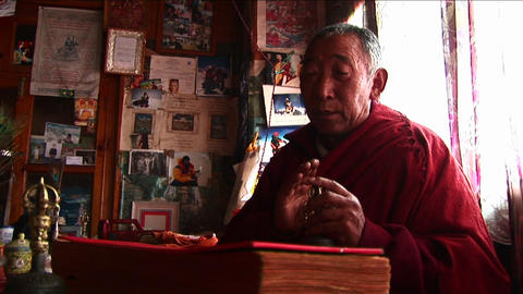 Lama chanting prayer in temple Stock Video Footage