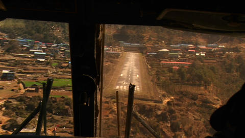 Cockpit view of plane landing at Lukla Stock Video Footage