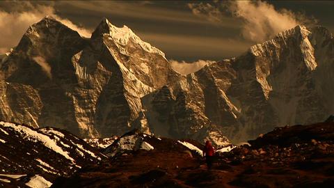 Trekker walking towards high himalayas Stock Video Footage