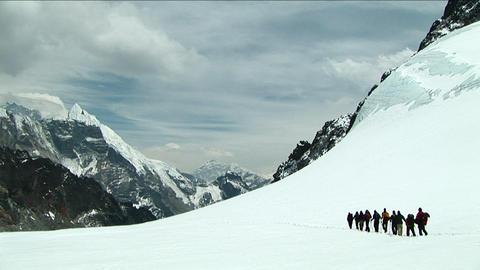 Climbers walking across snowy plateau Stock Video Footage
