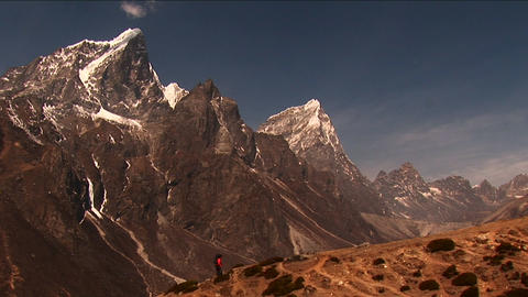 Trekker against mountain backdrop Stock Video Footage