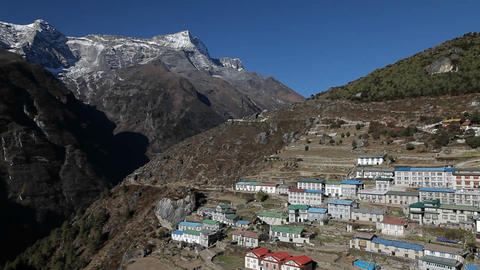Pan of Namche Bazaar in daylight Stock Video Footage