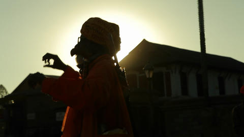 Nepalese man dancing in the sunlight Stock Video Footage