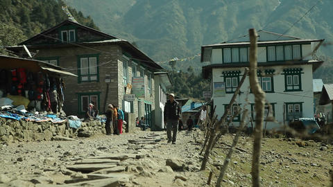 Man walking down road in Lukla Stock Video Footage