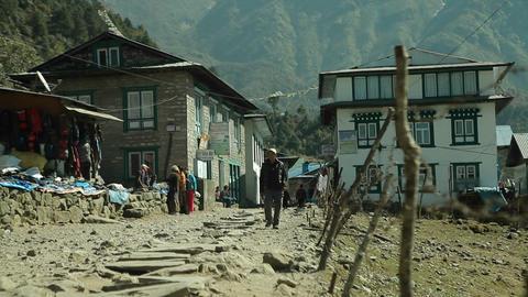 Man walking down road in Lukla Stock Video Footage