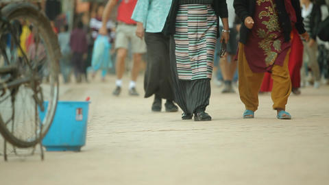 Sliding shot of peoples feet walking down street Stock Video Footage