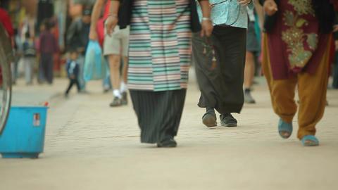 Sliding shot of peoples feet walking down street Footage