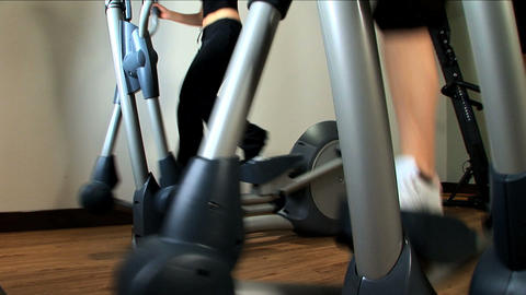 Beautiful blonde girl enjoys working out at the gym Stock Video Footage