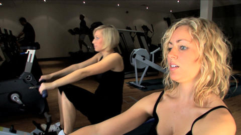 Beautiful blonde girls enjoy working out at the gym Stock Video Footage