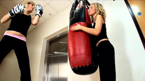 Beautiful blonde girls boxing at the gym Stock Video Footage