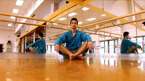 Young man practising yoga Stock Video Footage