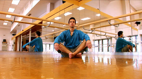 Young man practising yoga Footage