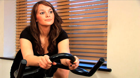 Beautiful brunette girl enjoys working out at the gym Footage