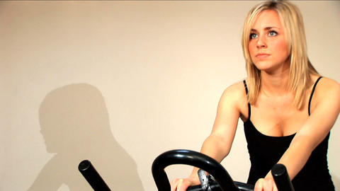 Beautiful blonde girl enjoys working out at the gym Footage
