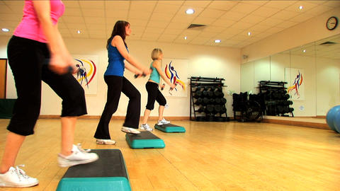 Beautiful young girls doing aerobic exercises at a gym Stock Video Footage