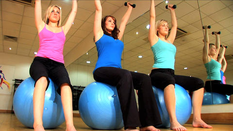 Beautiful young girls doing exercises at a gym Footage