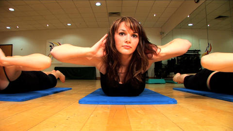 Beautiful young girls exercising at a gym Stock Video Footage