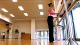 Attractive Slim Brunette Girl Practising Yoga Exercises At A Gym stock footage
