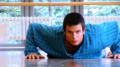 Attractive young man practising yoga exercises at a gym Footage
