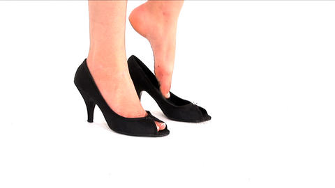 Woman Putting On Her Shoes And Going Out stock footage