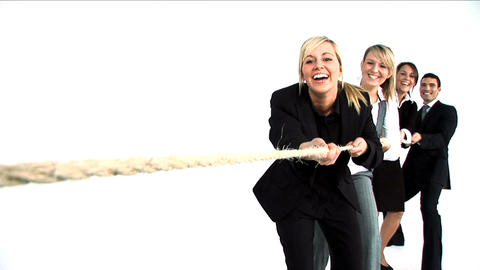 Team pulling a rope in a tug of war Stock Video Footage