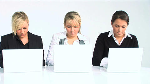 Three women typing on laptop Footage