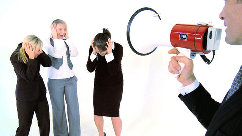 Businessman speaking throught a megaphone at his... Stock Video Footage