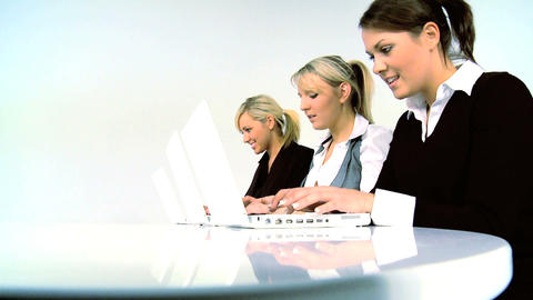 Three women typing on PCr Stock Video Footage