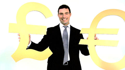 Businessman holding gold euro and pound symbol isolated on white Footage