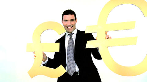 Businessman holding gold euro and pound symbol isolated... Stock Video Footage