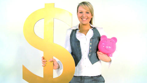 Happy businesswoman holding piggy bank and dollar symbol... Stock Video Footage