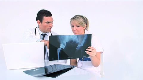 Healthworkers analyzing x-ray Footage