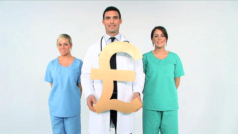 Medical team with pound symbol on white background Stock Video Footage
