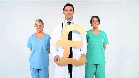 Medical team with pound symbol on white background Footage