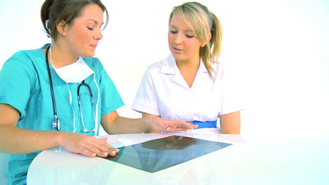 Young woman medical team analyzing x-ray, motion jib Stock Video Footage