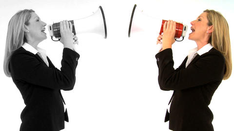 Female twins shouting at each other with megaphone... Stock Video Footage