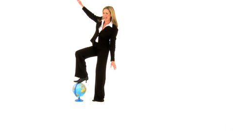 Beautiful businesswoman balancing on the globe isolated in white Footage