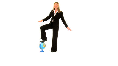 Beautiful businesswoman balancing on the globe isolated... Stock Video Footage
