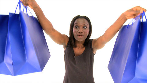 Attractive african american woman holding several shopping bags Footage