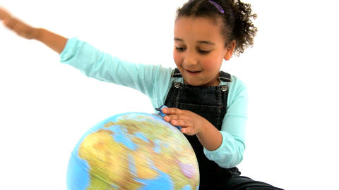 An adorable african american girl playing with a globe... Stock Video Footage