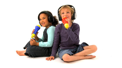 African american girl and blonde boy singing on white background Footage