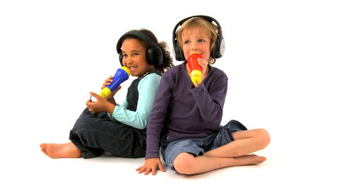 African american girl and blonde boy singing on white... Stock Video Footage