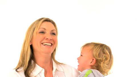 Mother and her cute son singing isolated on white Stock Video Footage