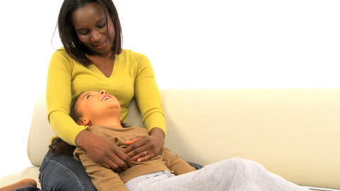 African american woman tickling her cute daughter Stock Video Footage