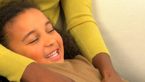 African american woman tickling her cute daughter, motion... Stock Video Footage